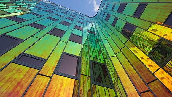coloured glass office building looking up