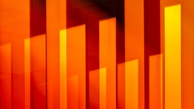 orange abstract bars behind get in touch text